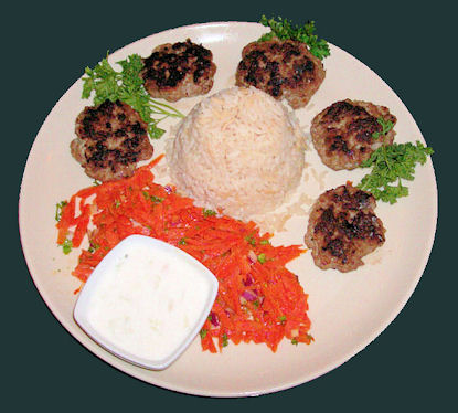 small crab cakes with rice on a plate