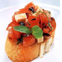 bread topped with sliced tomatoes and basil
