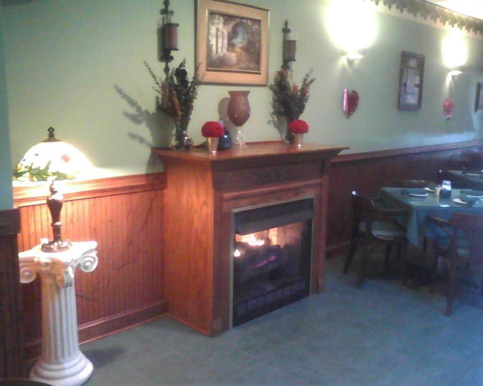 interior dining area with a fireplace