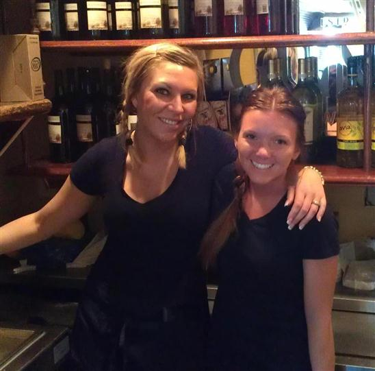 Two employees posing for the camera