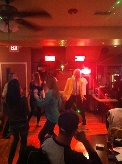 Sir Rod performing at Casey's with people dancing on the dance floor