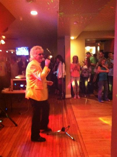 Sir Rod performing at Casey's with people watching in the background