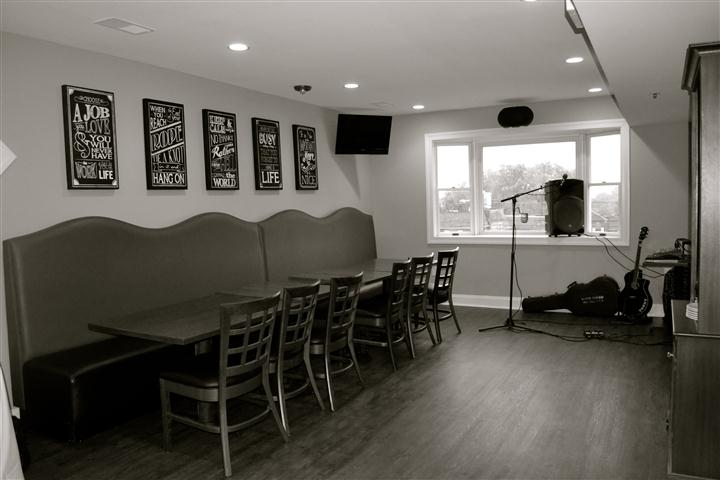black and white photo of round tables and chairs in the dining room