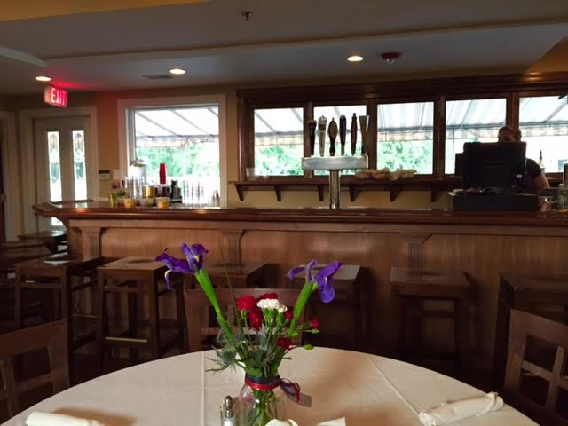 a view of the bar from round table with table cloth