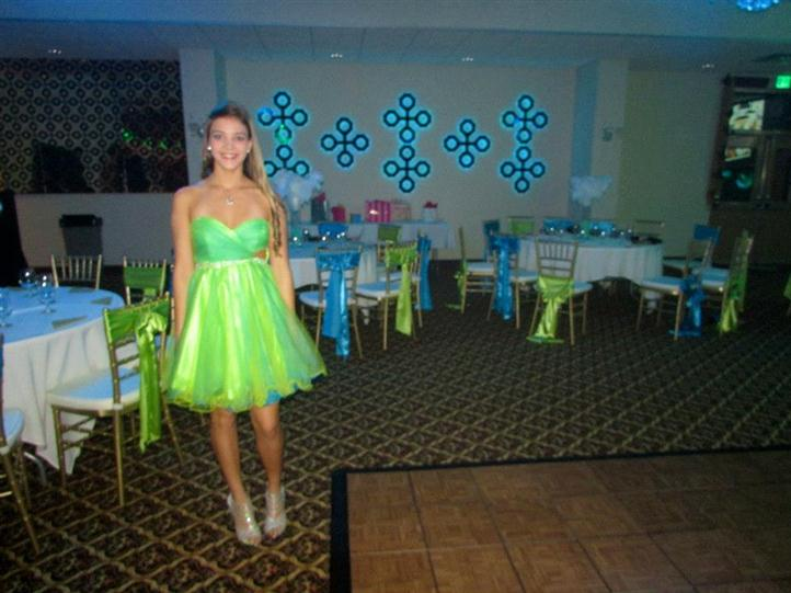 carlyn posing for picture in front of decorated round tables