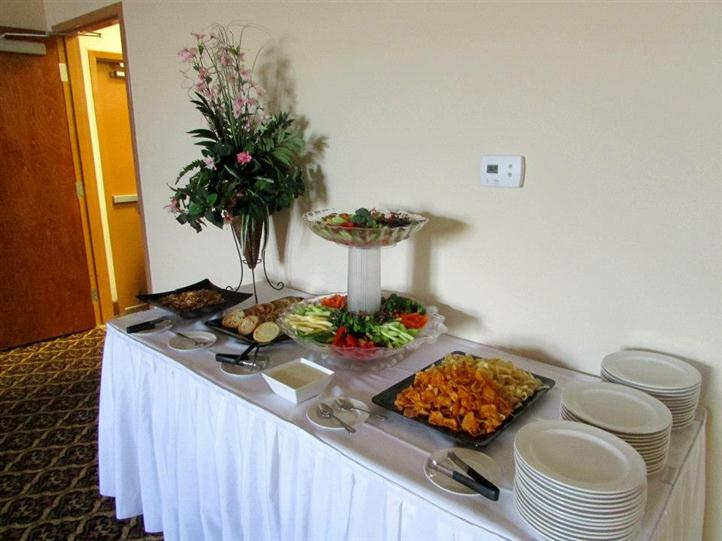 buffet table with plates and assortment of food