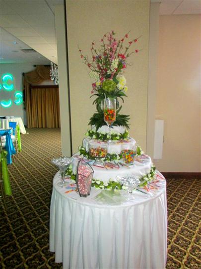 large birthday cake on top of a clothed-table