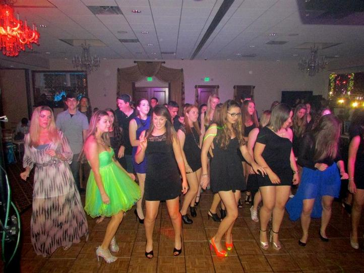 group of people at birthday party dancing