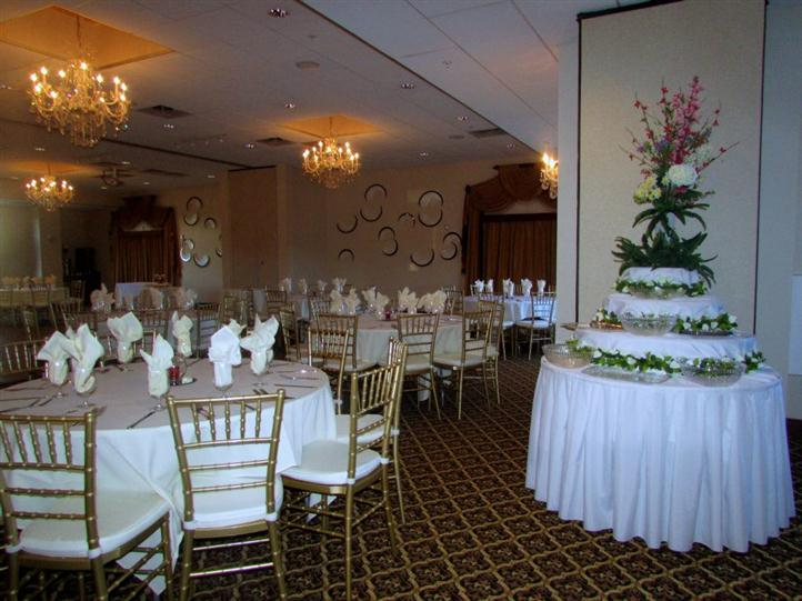 banquet room with several tables decorated for sita's 60th birthday party