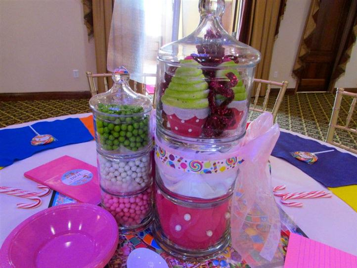 center of table with jars full of candy