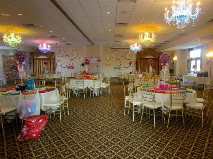 large banquet room with several decorated tables