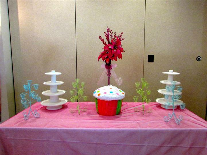 table with large decorated cupcake