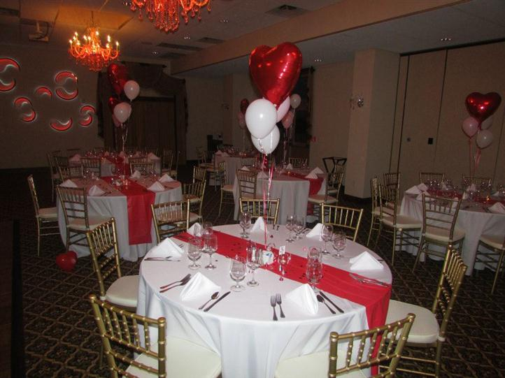 round table decorated with heart-shaped balloons
