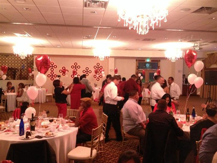 banquet room filled with people for valentine's day dinner event
