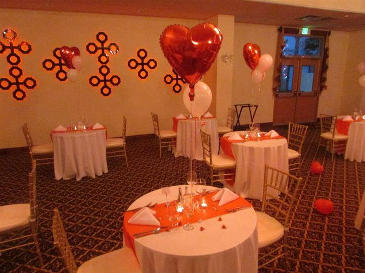 several round tables decorated with balloons