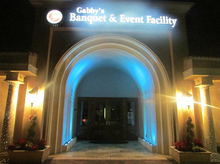 archway with sign above it that reads gabby's banquet & event facility