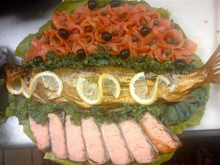 Fish on a platter with other meats and vegetables