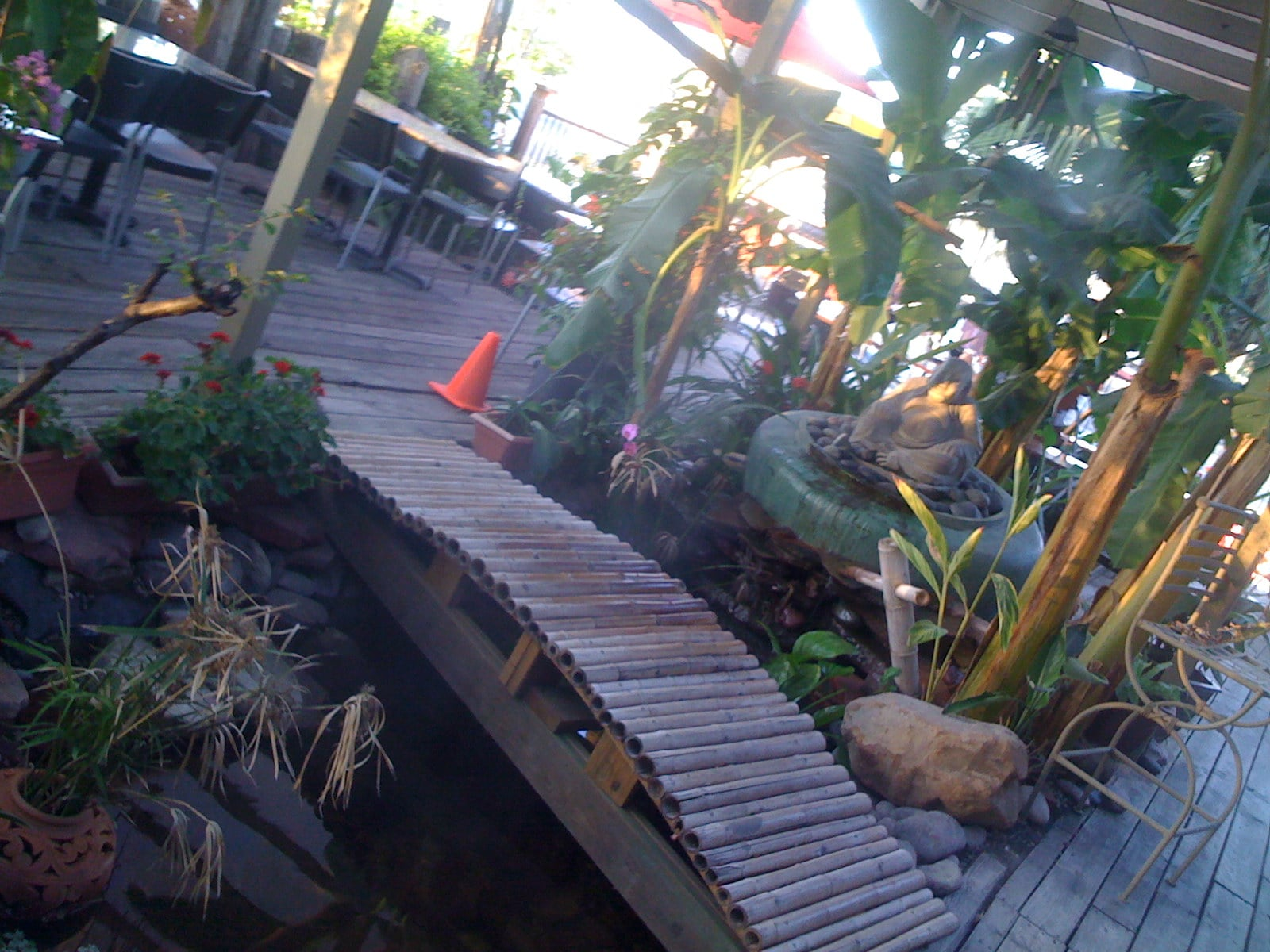 Outdoor deck with small bamboo bridge