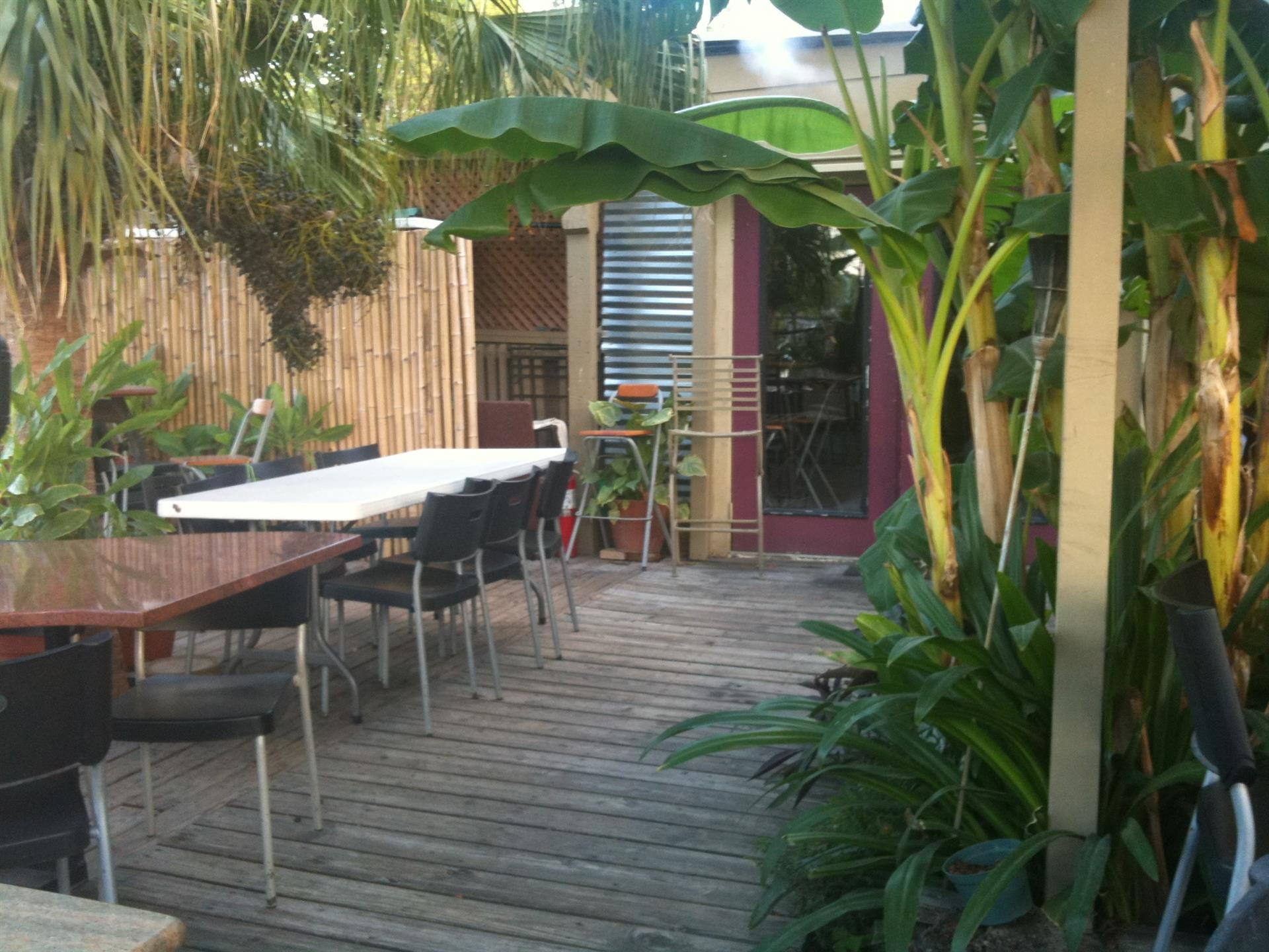 Outdoor deck with tables and large plants