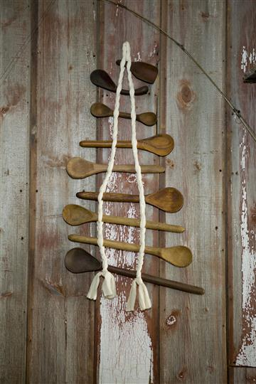 Column of wooden spoons