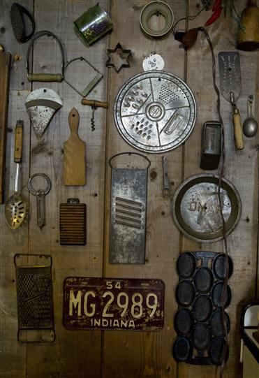 Wall decoration of different vintage signs and tools