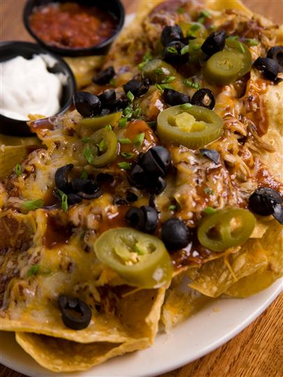Nachos with jalapenos and sour cream