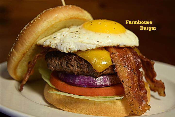 Bacon cheese burger with an egg sunny side up