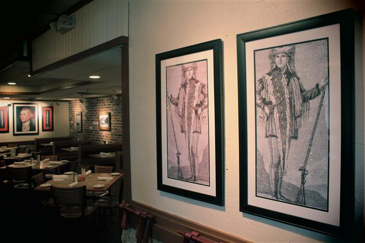 Paintings next to dining area