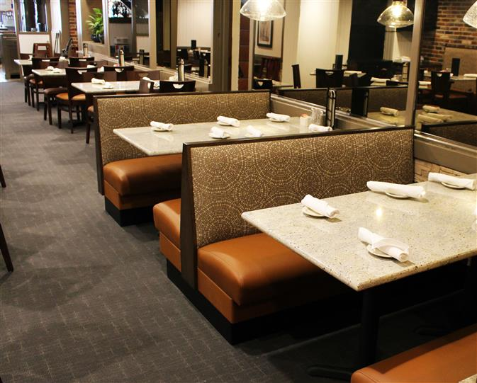 Dining area  with rolled napkins