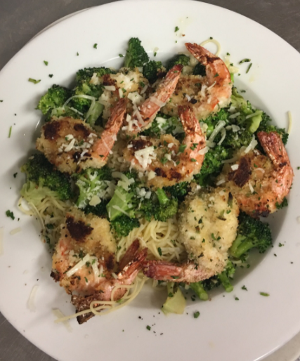Grilled shrimp Cesar salad with grated parmesan cheese