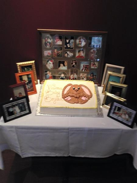 Cake on table with photo decorations