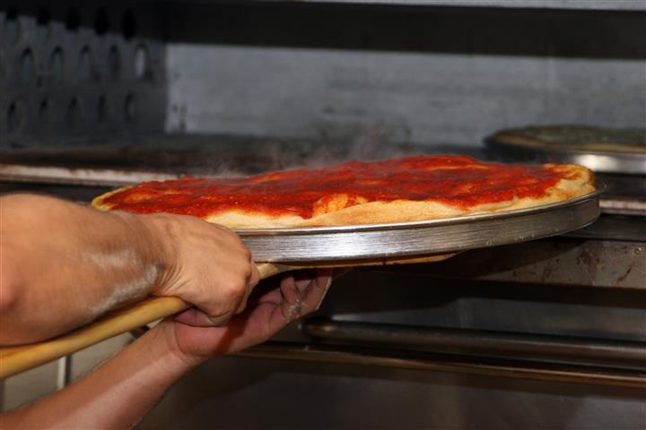 Pizza going in oven
