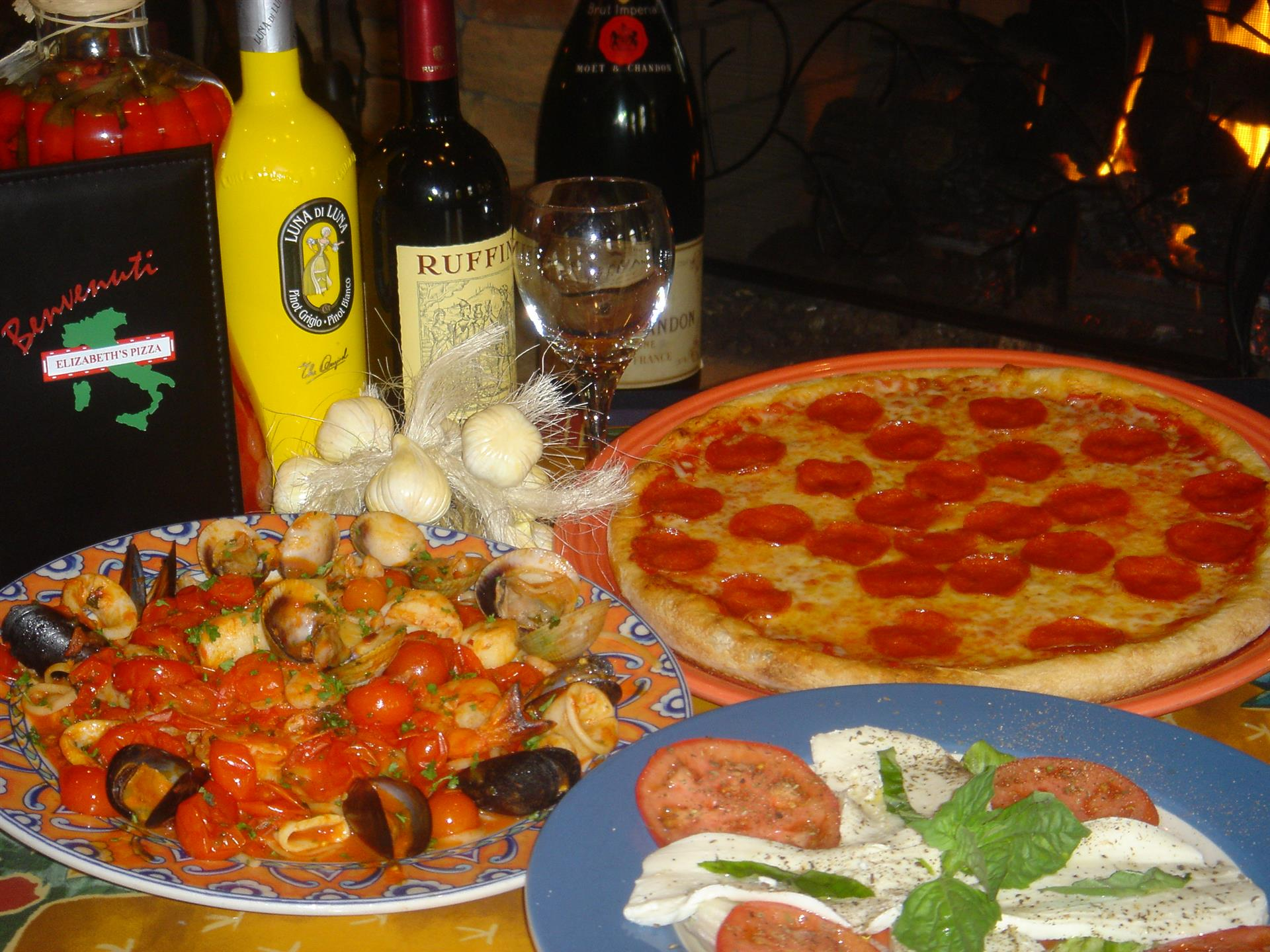 pepperoni with other entrees and several bottles of wine