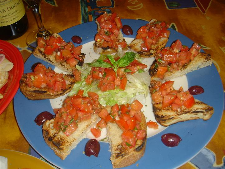toasted bread topped with tomatoes on a plate