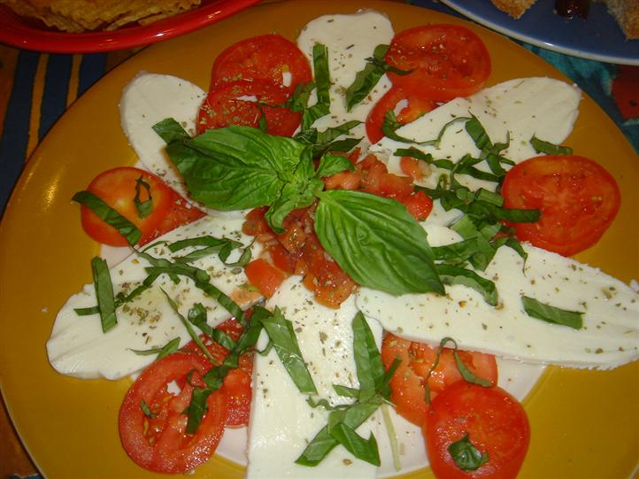 cheese topped with garnish and tomatoes