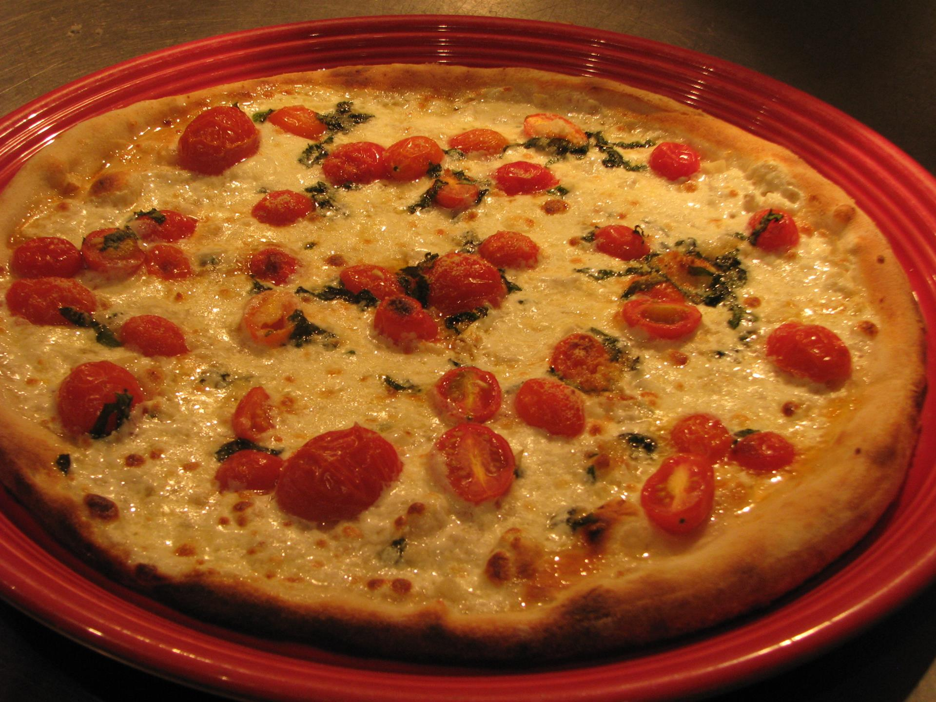 cheese pizza topped with tomatoes