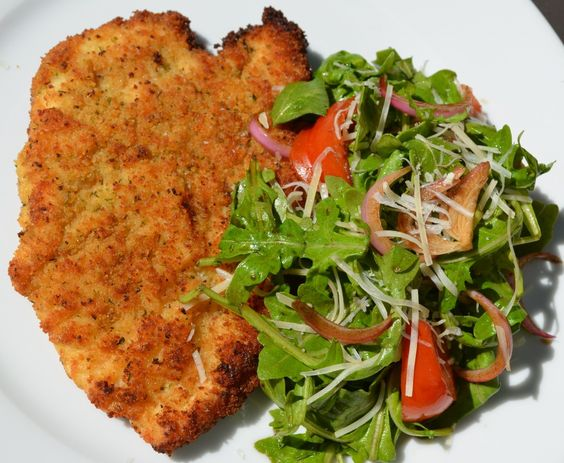 breaded meat with a side salad