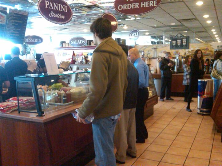 customers waiting in line at a counter