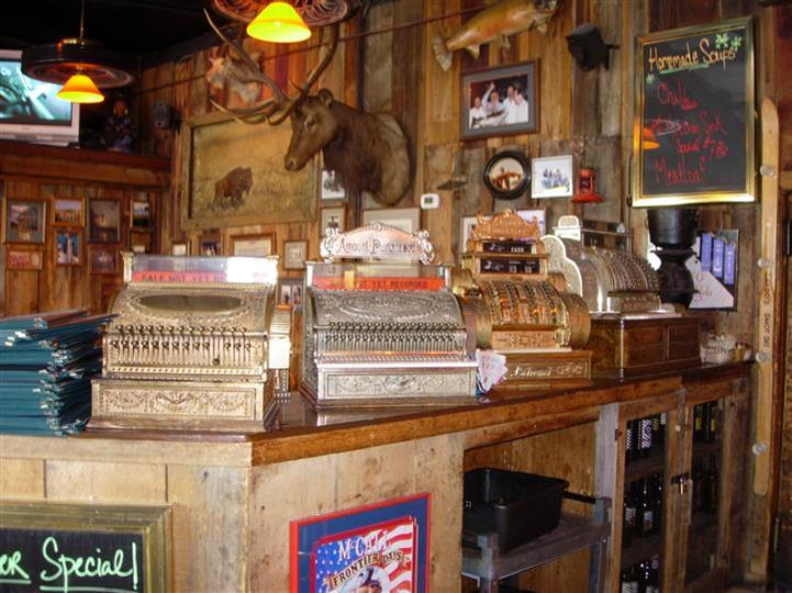Interior shot of the saloon's bar with old style cashier mashines