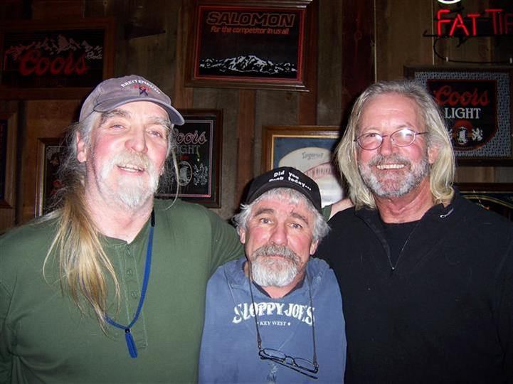 Three men smiling posing for a photo in Lardo's Grill & Saloon