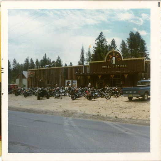 A picture of  a lot of motorcycles pakred outside Lardo's Grill & Saloon