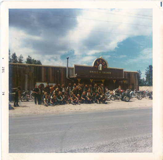 A picture of a group of motorcyclist with outside Lardo's Grill & Saloon