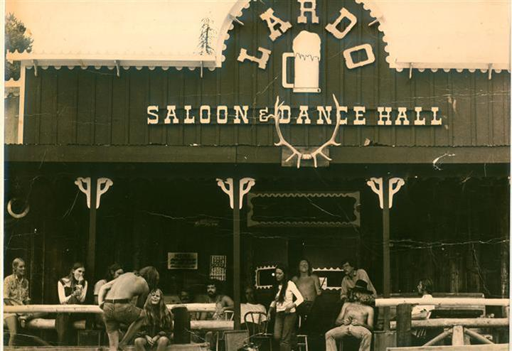 Outdoor black and white photo of Lardo's Grill & Saloon with people in the 70s