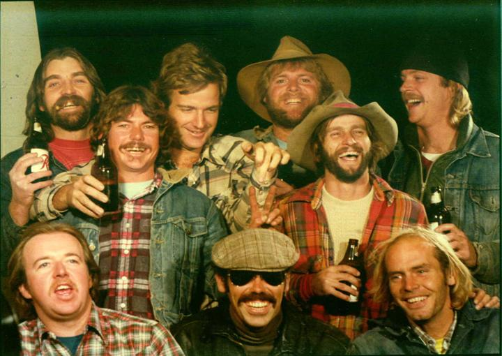 Nine men in the 70s posing for a photo