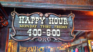 sign read happy hour monday thru friday 4-6