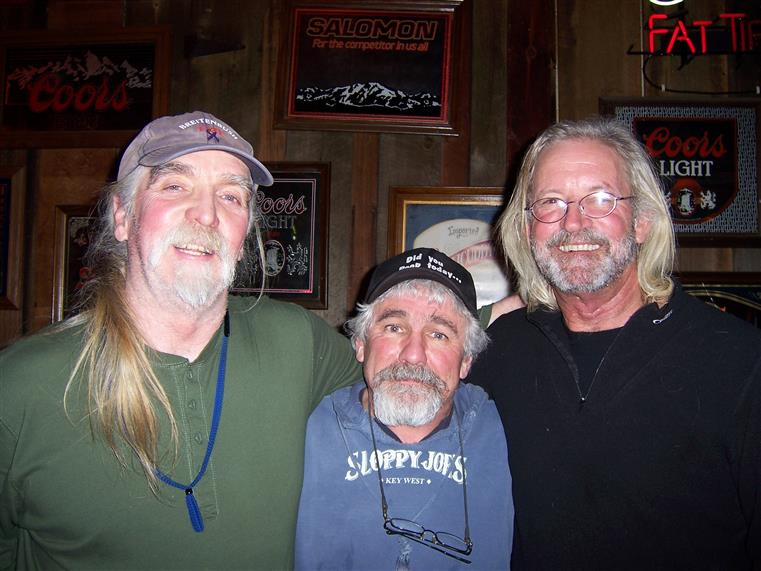 three men posing for picture