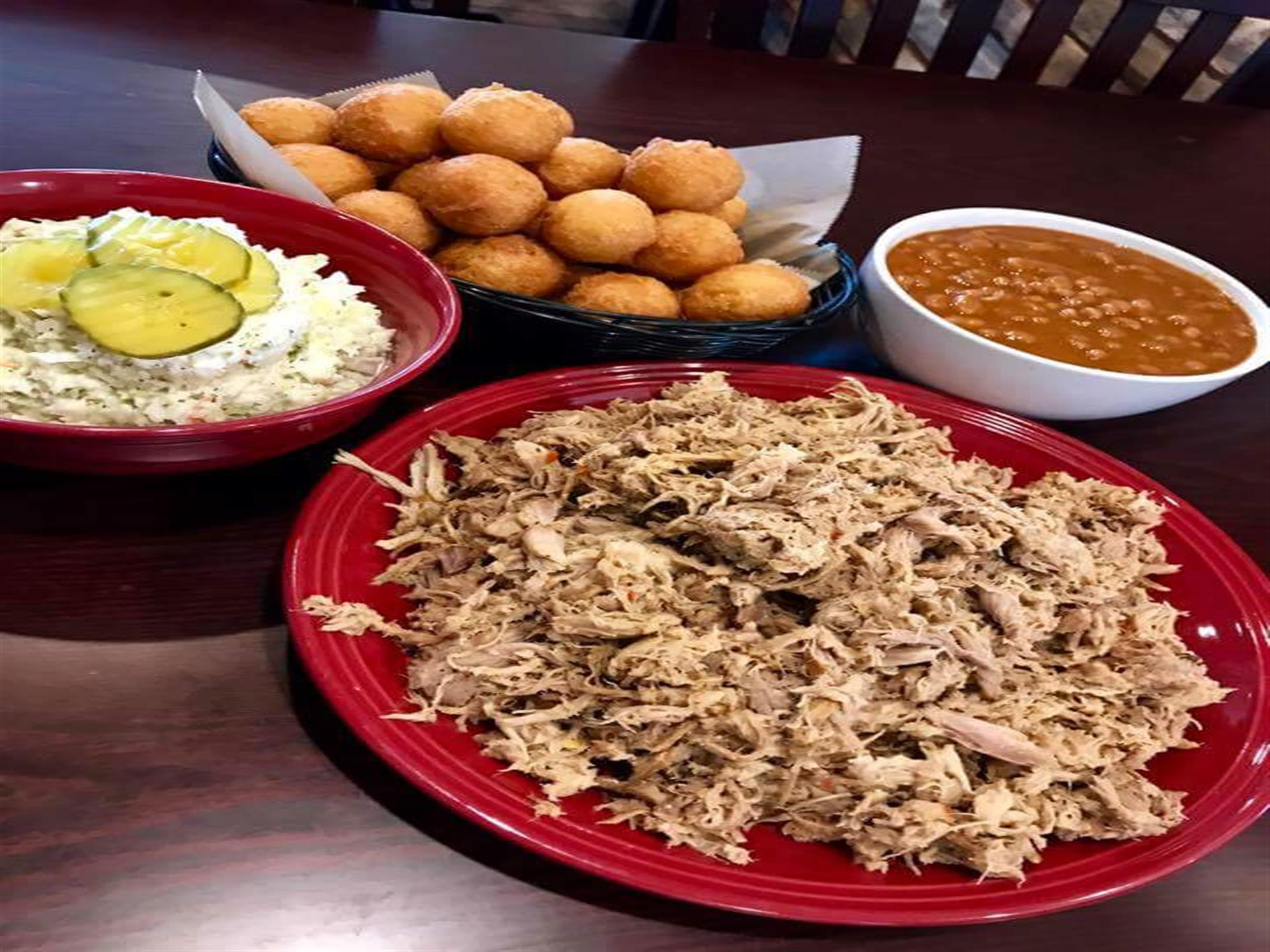 shredded chicken served with coleslaw, hush puppies and baked beans