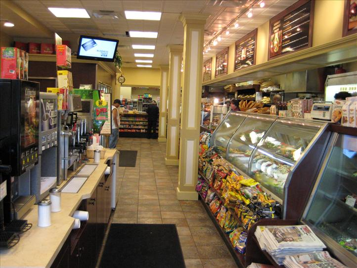 Entryway showing display cases, coffee station, menu boards
