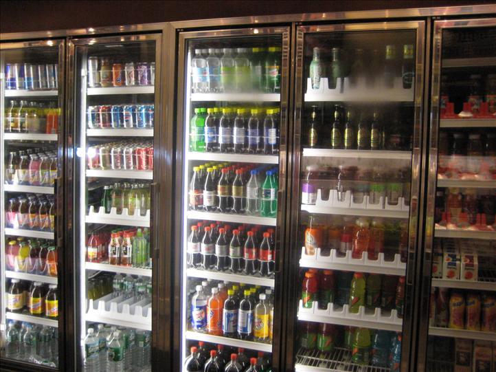 Refrigerated cases with soda, sports drinks, water bottles.