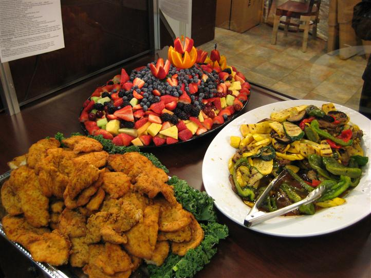 Chicken and fruit on platters for an event